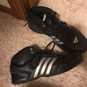 Black and silver adidas mid top basketball shoes